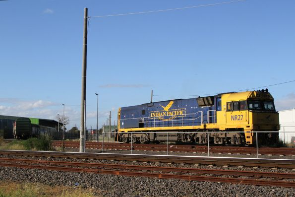Indian Pacific liveried NR27 shunts the Sadleirs vans at Spotswood