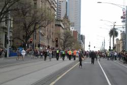 Tail end of the march finally clears the corner of Collins and Spring Street