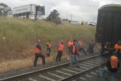 Breakdown crew wait for a V/Line train to overtake the troublesome SCT train