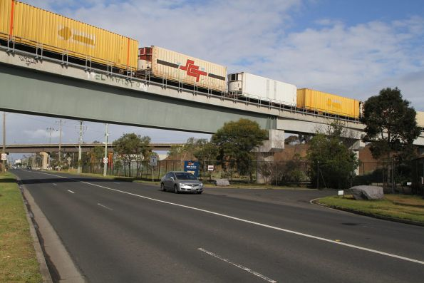 A mix of SCT and ex-Aurizon containers northbound on MB9 cross over the bridge at Tottenham