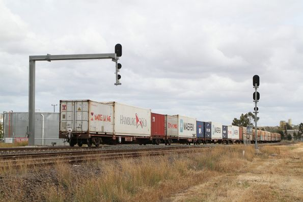 Container wagons along with SCT vans on 7606 up Barnawartha freight through Albion