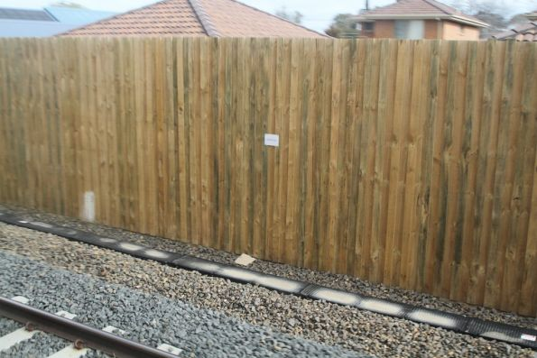 Tall timber fence in an attempt to protect neighbouring residents from rail noise from the temporary track slew at Seaford