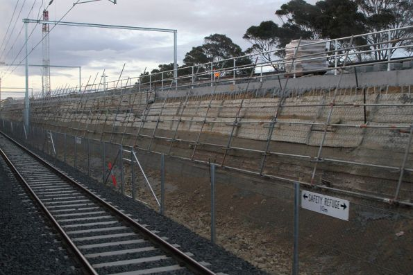 Temporary retaining wall on the west side of the future elevated tracks over Seaford Road