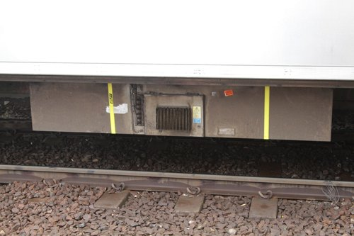 Tie-down straps affixed to a static inverter beneath a Siemens train