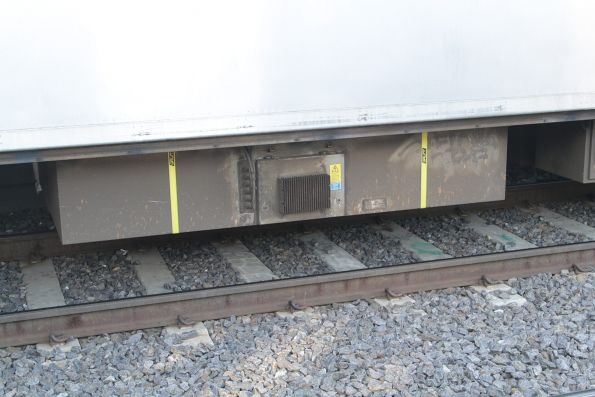 'Cable' side of a static inverter beneath a Siemens train, with fire blanket and tie down straps fitted