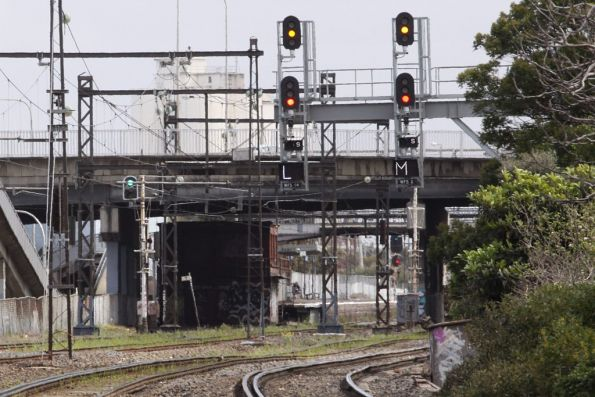 Signals cleared for two parallel running down movements at West Footscray Junction on the goods lines