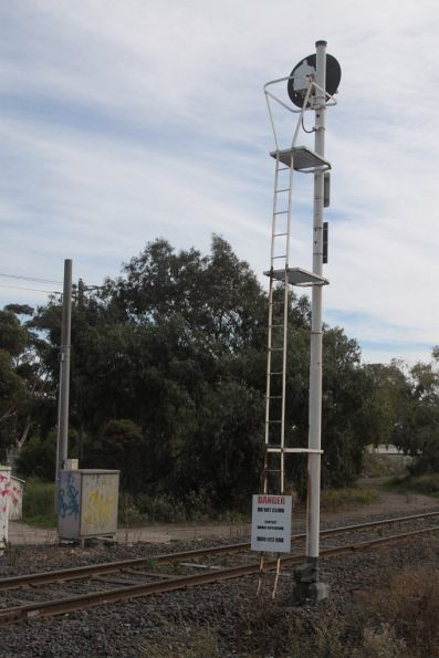 Signal mast with a 'DANGER: do not climb' sign on it