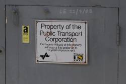 'Property of the Public  Transport Corporation' sign on a signal equipment room