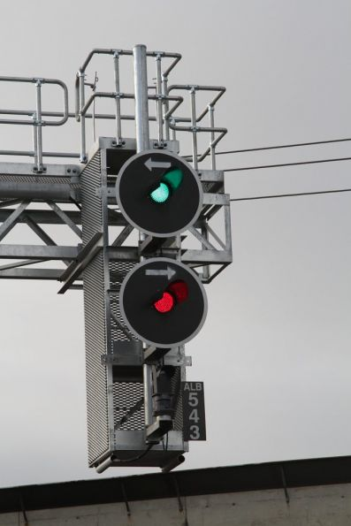 Hand-drawn directional indicators on recently installed signal ALB543 at Albion