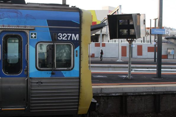 Driver at Footscray platform 5 looking at the SPOT monitor to check all of the doors are clear before departing