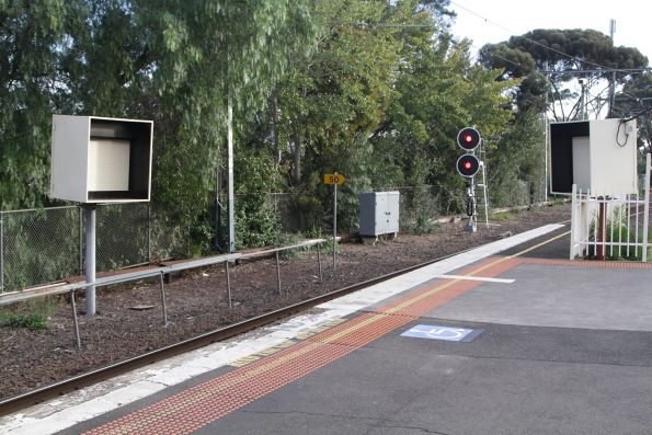 SPOT monitors for down trains on both sides of the track at Essendon platform 3