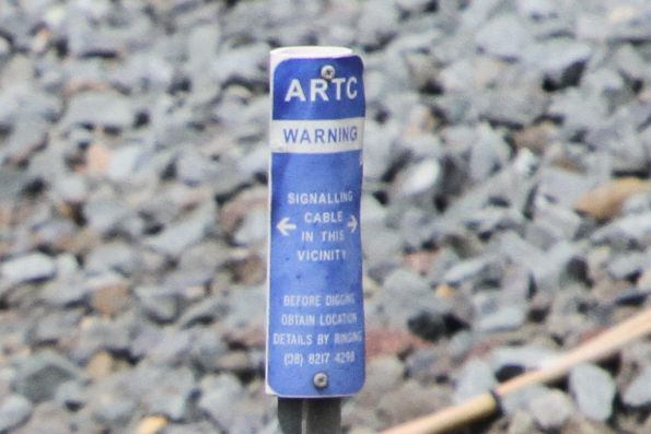 ARTC 'warning: signalling cable in this vicinity' sign