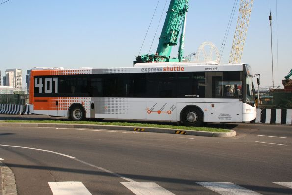 Sita bus #19 rego 6729AO on route 401 passes work on the new North Melbourne station concourse