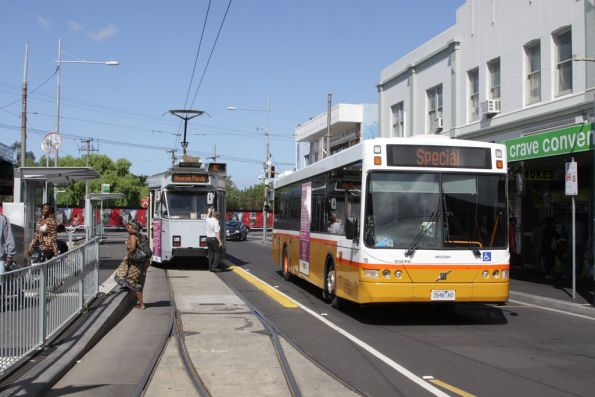 Sita #110 7646AO passes Z3.122 at the Footscray tram terminus