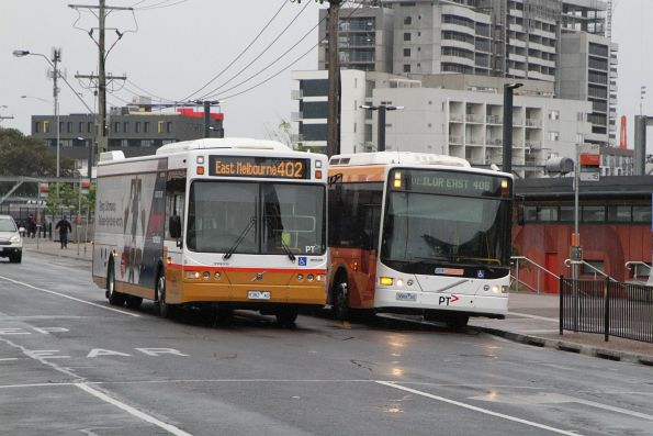 Sita bus #124 9382AO on route 402 passes CDC Melbourne bus #63 3886AO on route 406 at Footscray station