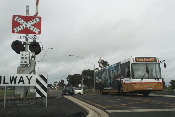 Sita bus #39 6837AO on route 457 crosses the Coburns Road level crossing in Melton