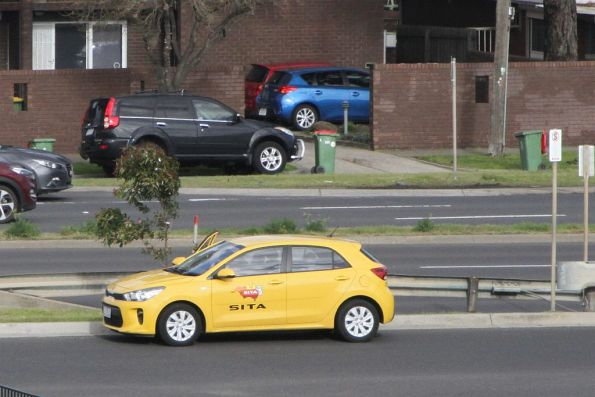Route 472 driver waiting with a Sita changeover car on Geelong Road, West Footscray