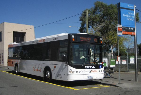 Sita bus #43 rego 6728AO waits for route 401 passengers at North Melbourne station