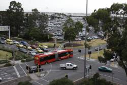 Main crossroads at Melbourne Airport - a SkyBus heads south down Centre Road