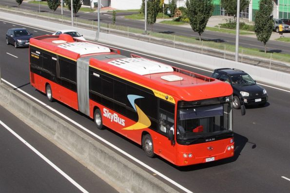 SkyBus articulated bus #74 7487AO on the Tullamarine Freeway near Essendon Airport