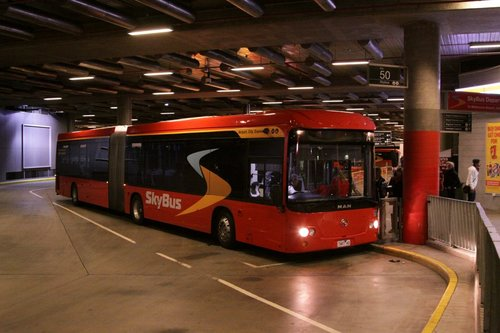SkyBus articulated bus 7487AO picking up passengers at Southern Cross