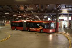 Passengers board a SkyBus articulated bus at Southern Cross Station