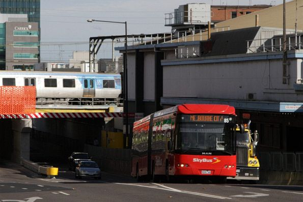 SkyBus articulated bus #85 9026AO passes beneath the railway lines on Dudley Street