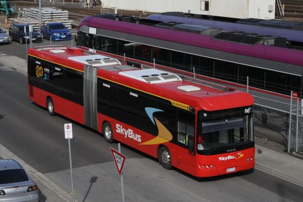 SkyBus articulated bus #86 rego 9027AO drives along the bus-only road out of Southern Cross Station