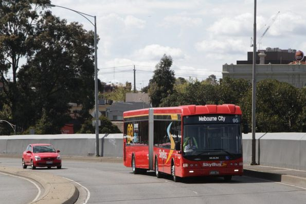 SkyBus articulated bus #95 rego BS00OH heads across the Dynon Road bridge
