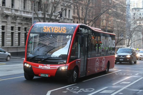 Skybus hotel shuttle #41 BS01PK heads north on William Street