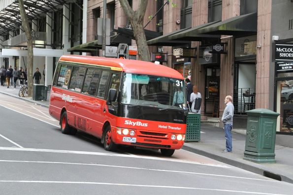 Skybus hotel shuttle #31 5179AO heads south at Queen and Little Collins Street