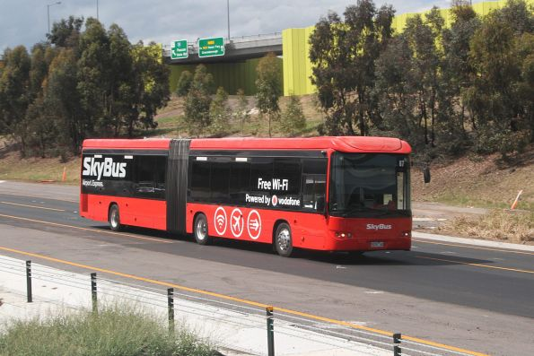 SkyBus articulated bus #87 9028AO southbound on the Tullamarine Freeway at the Western Ring Road