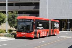 SkyBus articulated bus #83 BS00OE outside Melbourne Airport Terminal 4