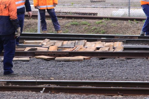 Pile of wooden packing pieces used to get the derailed 8114 back onto the rails