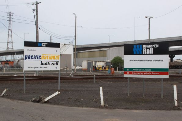 Downer EDI and Pacific National signs outside South Dynon - after so many ownership changes they have about 3 layers of stickers on them...
