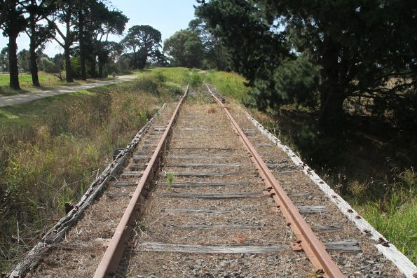 Tracks cross the timber pile bridge at Tooradin Station Road