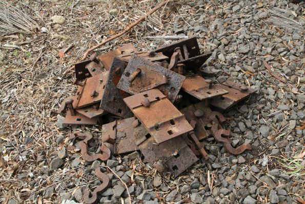 Pile of baseplates and dogspikes removed from the track