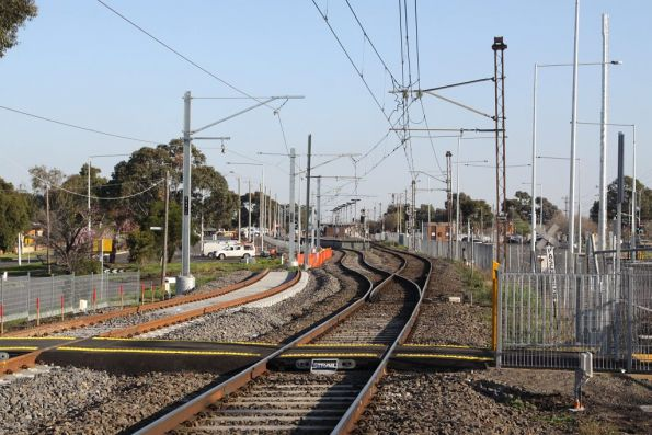New pedestrian crossing at the down end of Lalor station, new track waiting to be tied in