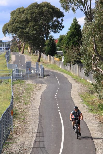 Bike rider heads along the track that parallels the railway