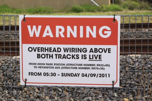 'Overhead wiring above both tracks is LIVE' warning sign