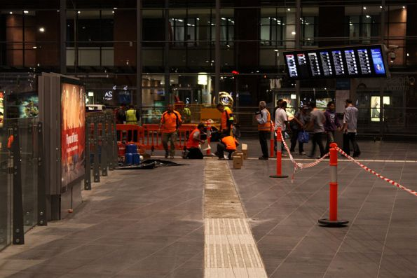 Fixing up the tactile paving yet again on the country concourse...