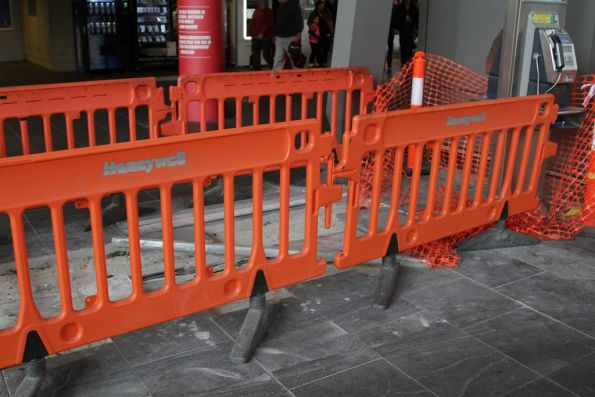 Work on installing new cables beneath the Collins Street concourse
