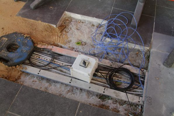 Rats nest of cables under repair