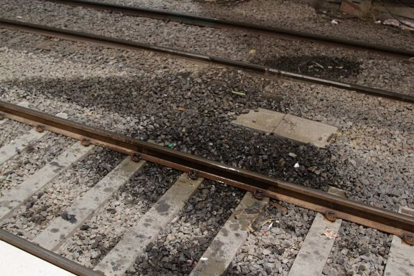Wet track on platforms 14 and 15 due to a leaking roof above