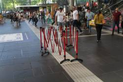Still more tactile paving having to be patched up on the Collins Street concourse
