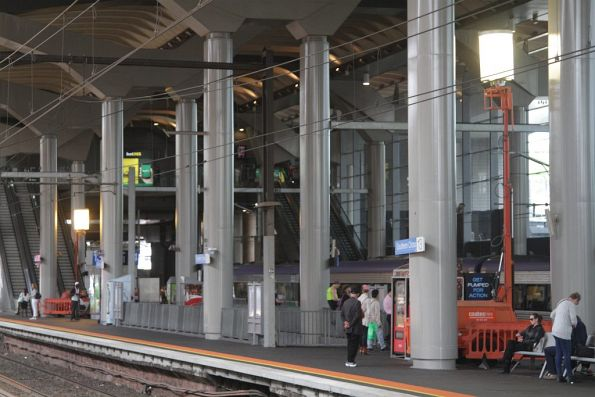 Portable floodlights running in the middle of the day at Southern Cross platform 13 and 14