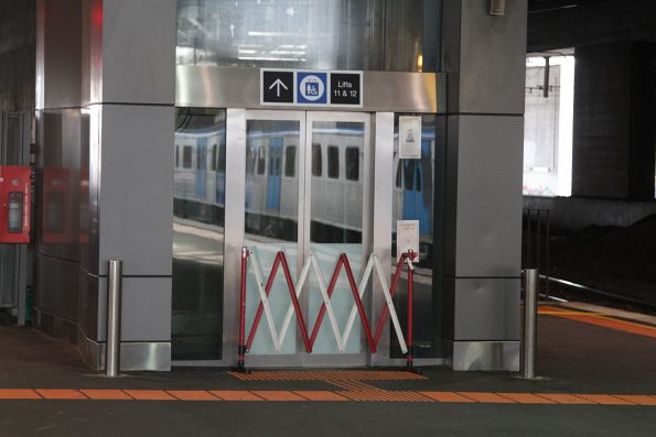 Broken down lift at the Collins Street end of platform 11 and 12