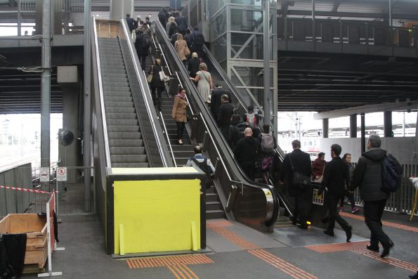 One out of two escalators out of service at the Bourke Street end of Southern Cross platform 9 and 10