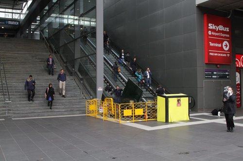 Failed escalator to the Bourke Street bridge under repair at Southern Cross