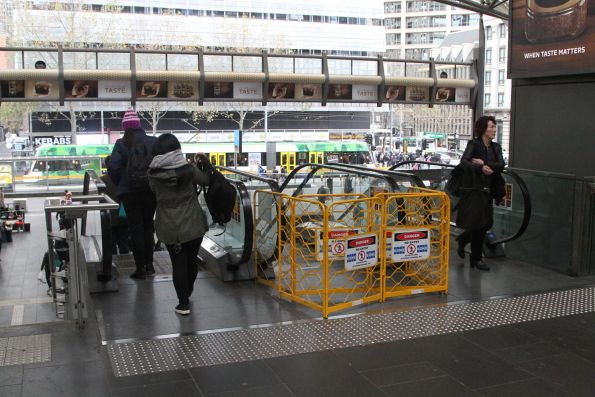 Defective escalator under repair on the Collins Street concourse at Southern Cross Station